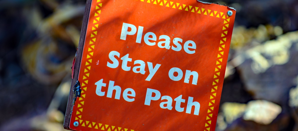 "Sign reading ""Please Stay on the Path"""